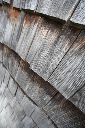 Detail einer Holzverschindelung